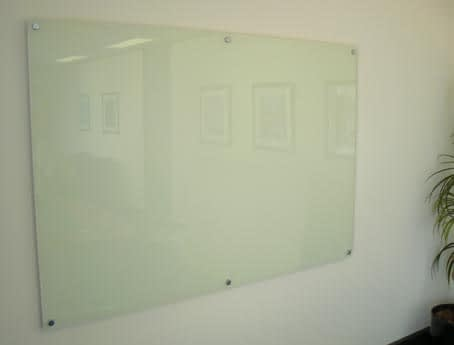 Photo of a toughened glass board on standoff mounts