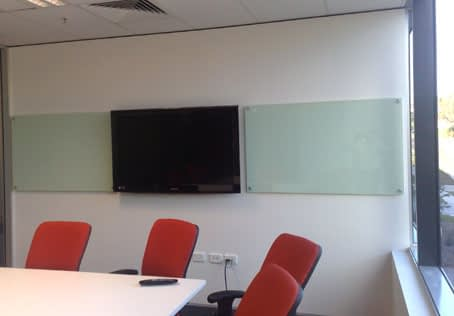 Photo of toughened glass boards either side of a TV